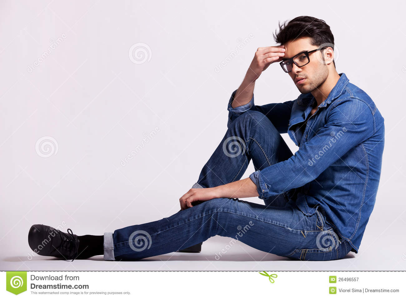 Male Model Sitting On Grey Background And Thinking Stock Image Image Of People Business 26496557