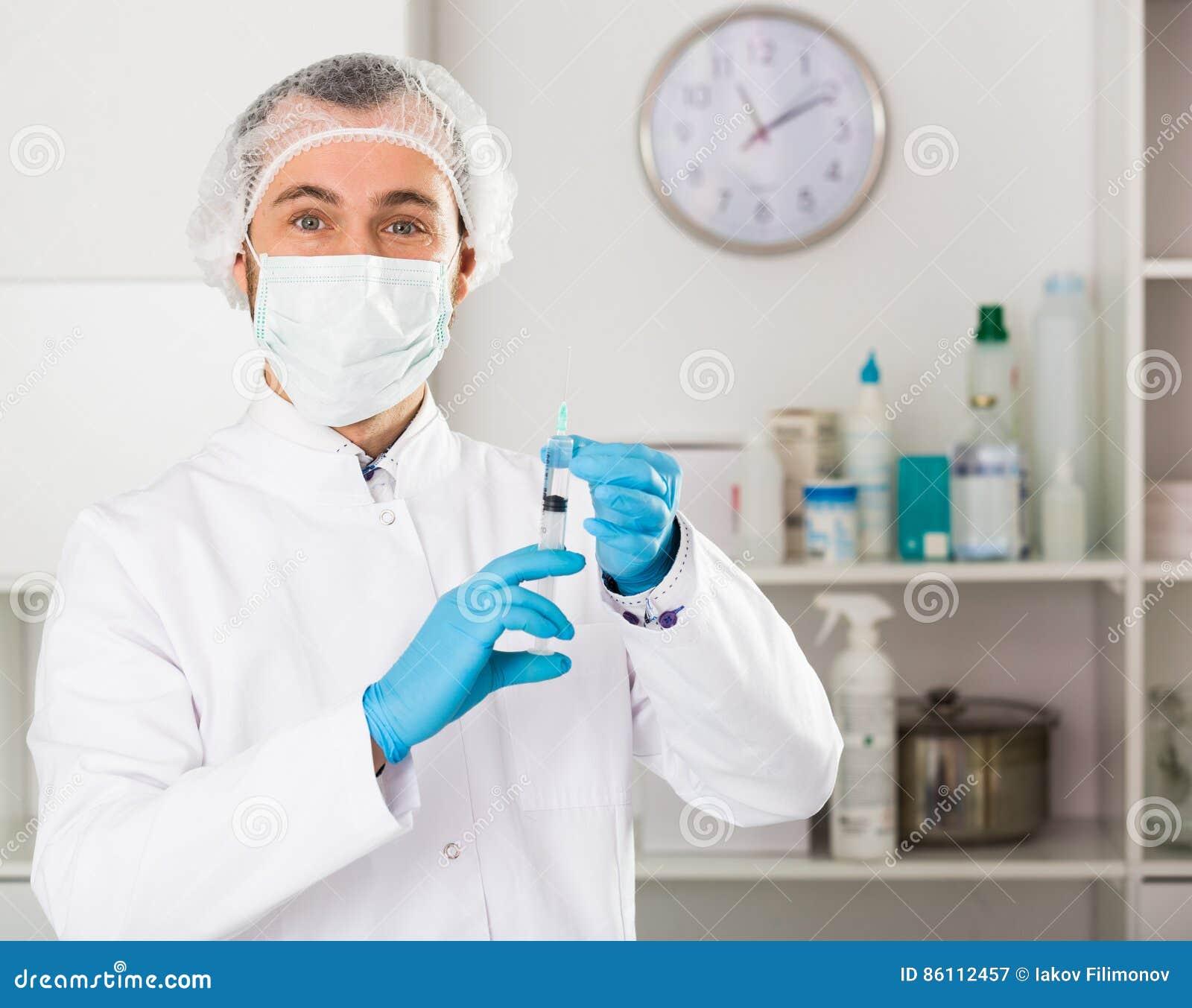 Male Nurse Preparing Injection Stock Image - Image of
