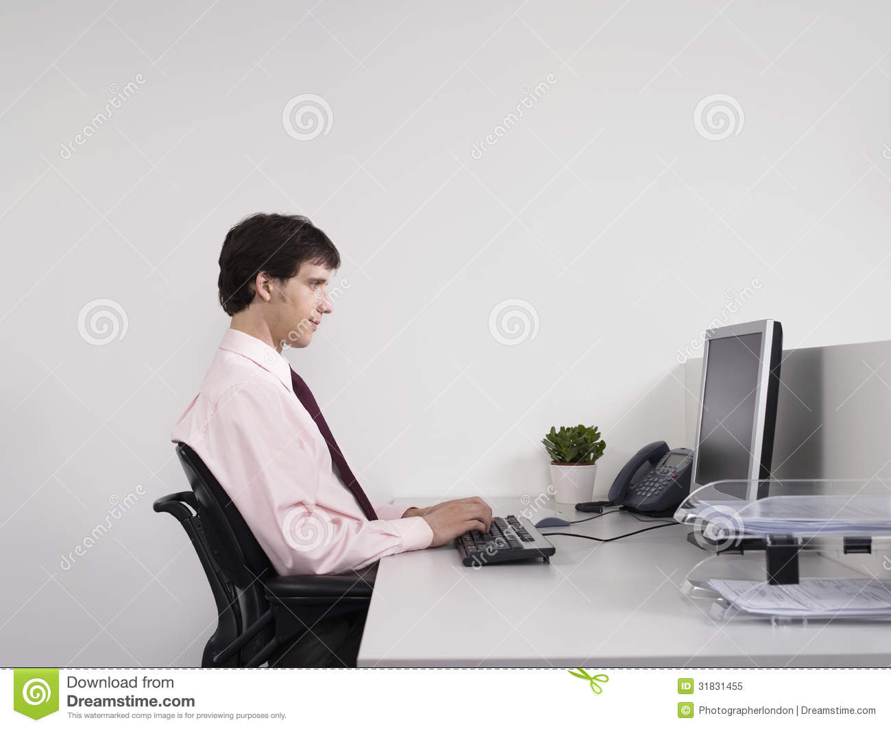 Young Office Worker At Computer stock vector art 77302697 - iStock
