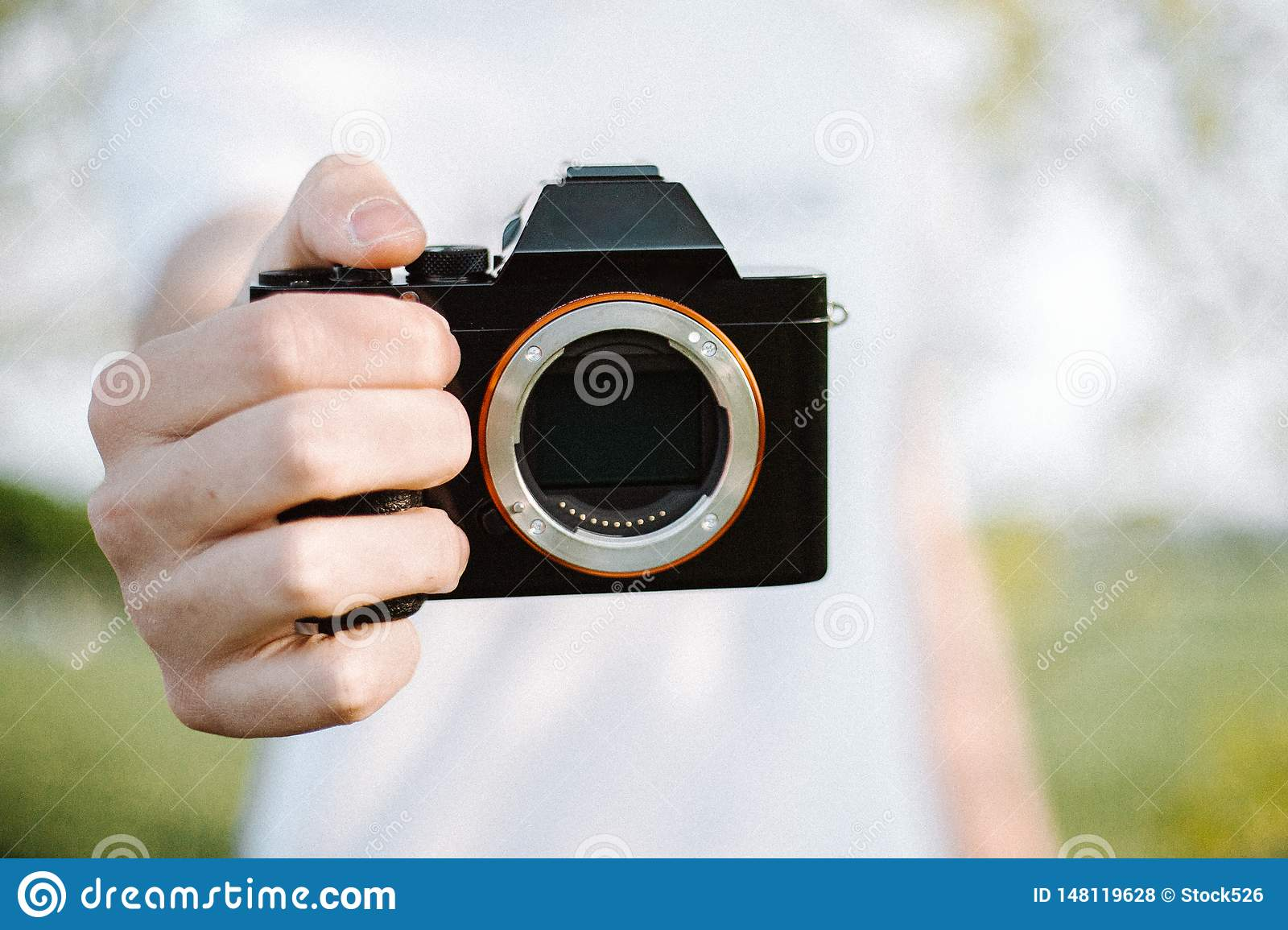 Male photographer is photographing with his camera
