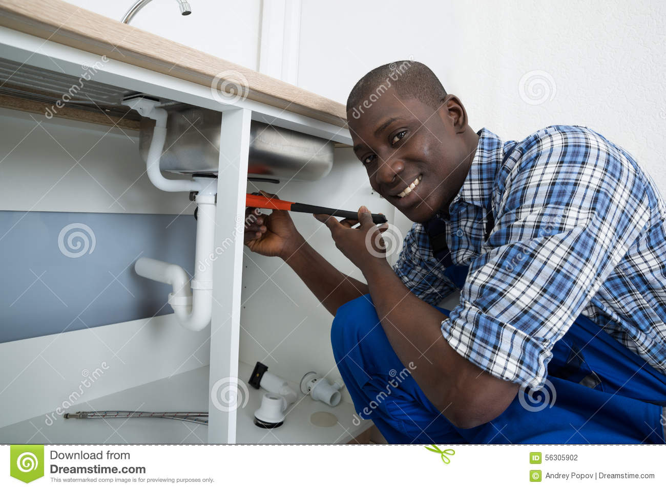 Male Plumber Fixing Pipe Of Sink Stock Photo Image 56305902