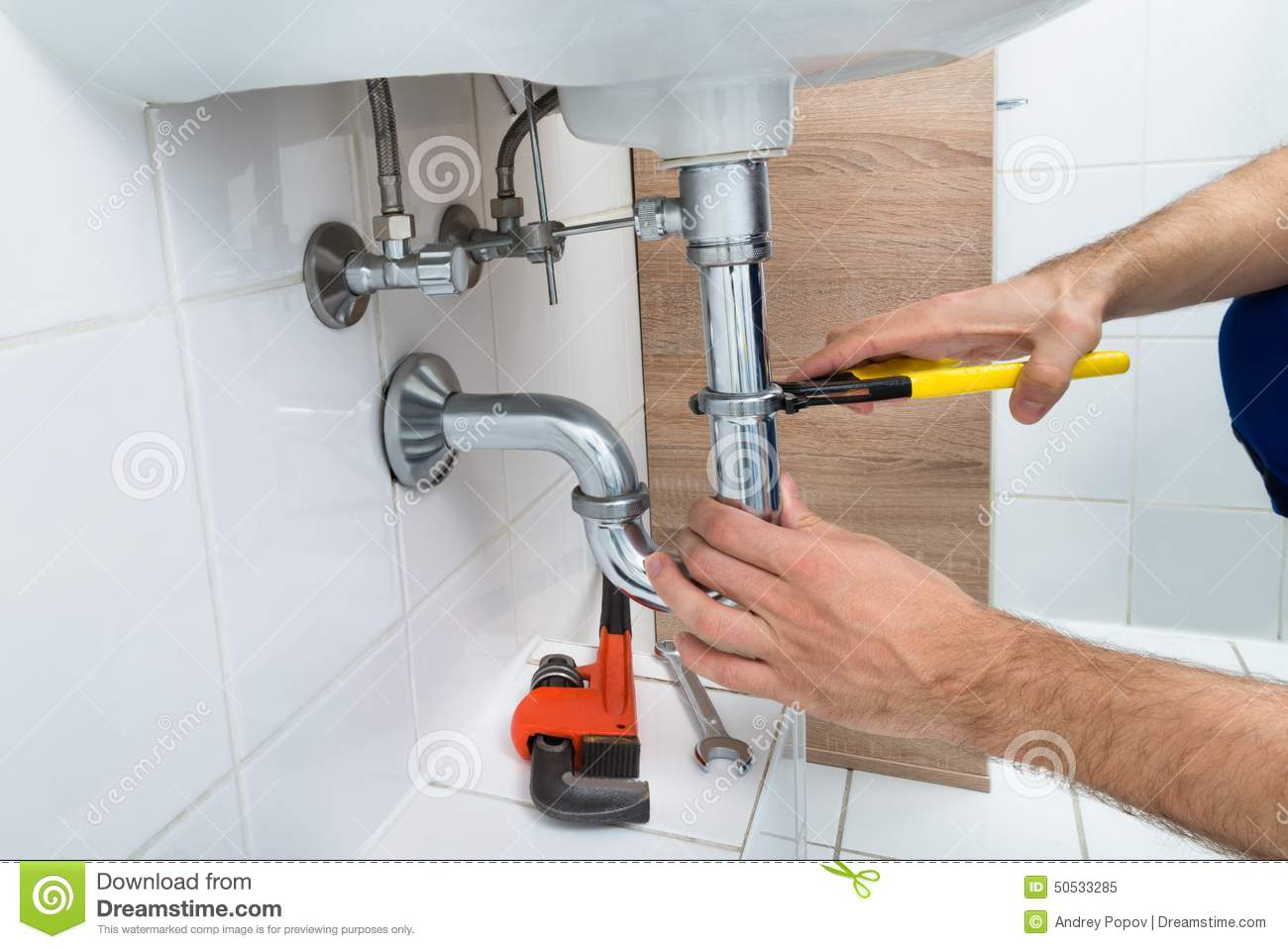 male-plumber-fixing-sink-bathroom-close-up-50533285.jpg