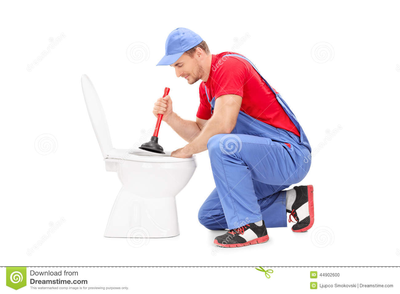 male plumber working on a toilet with plunger stock photo image 44902600. Black Bedroom Furniture Sets. Home Design Ideas