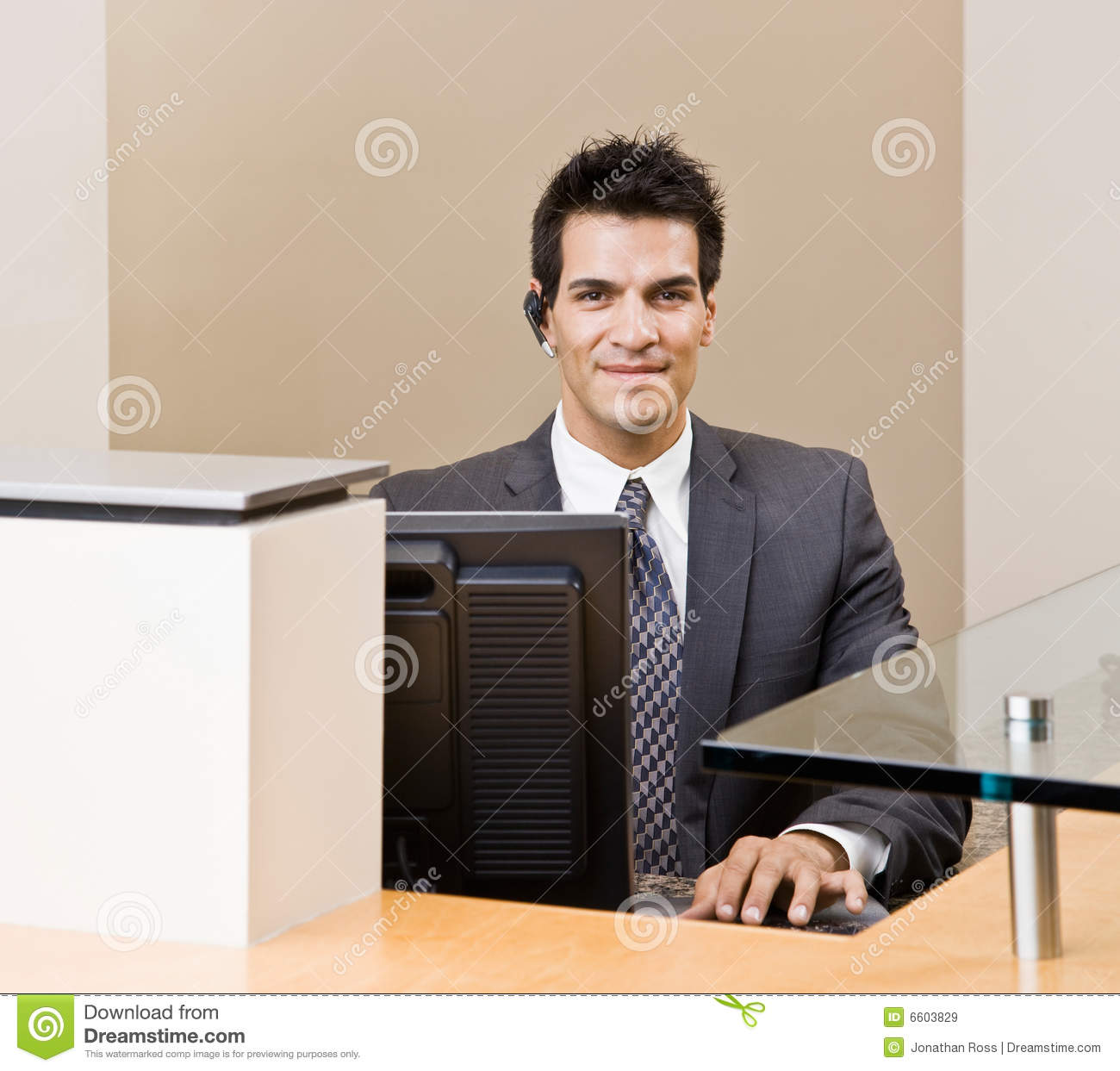 Male Receptionist With Telephone Earpiece Stock Image