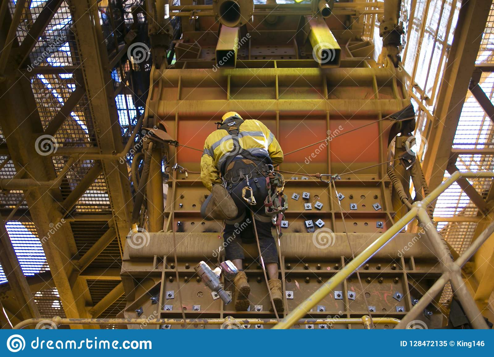 Male Rope Access Industry Worker Wearing Safety Harness