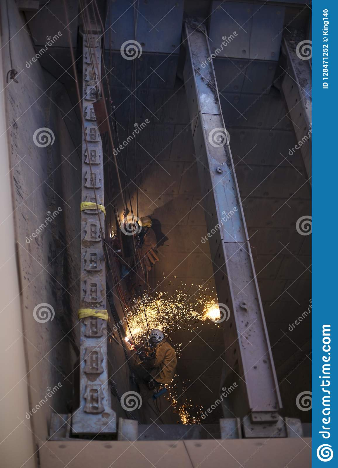 Male rope access miner are wearing safety harness helmet, fall body hot work equipment protection abseiling working on rope