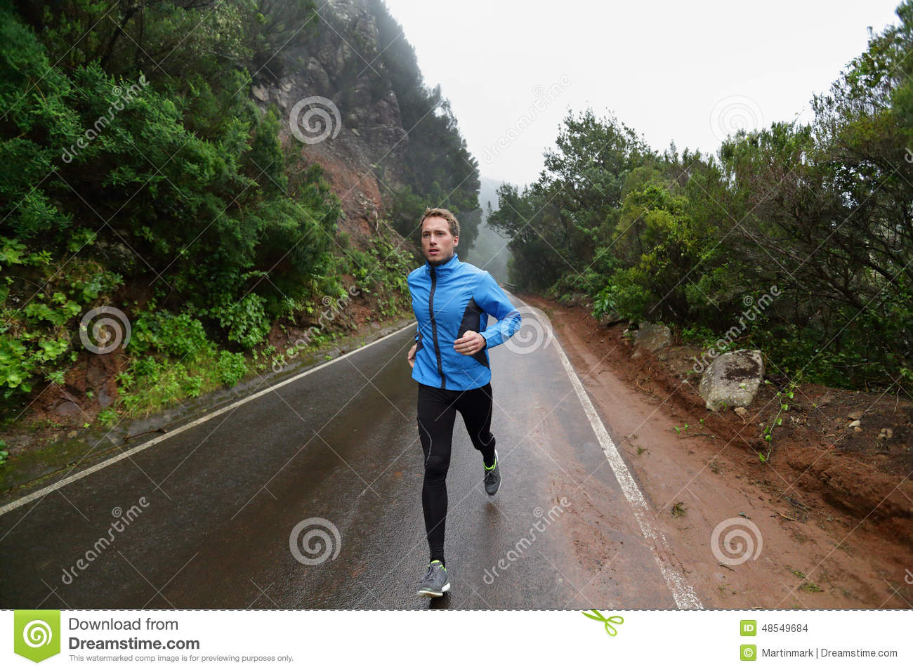 Male Runner Jogging And Running On Road In Nature Stock