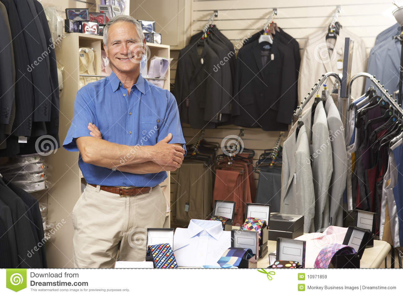 male sales assistant in clothing store royalty free stock