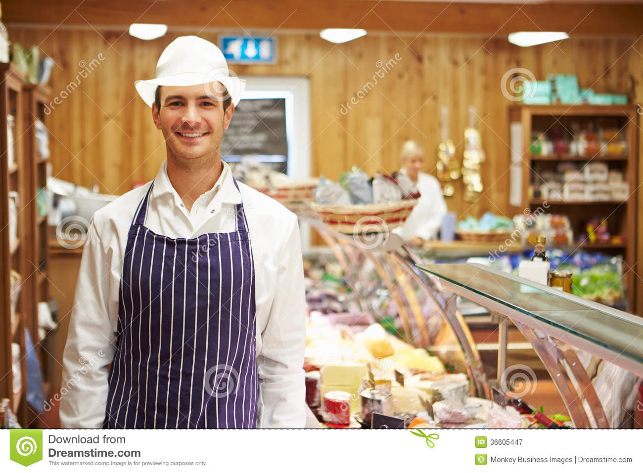 male sales assistant in delicatessen royalty free stock    male sales assistant in delicatessen