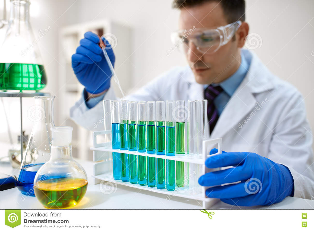 Male scientist using chemistry liquid for research