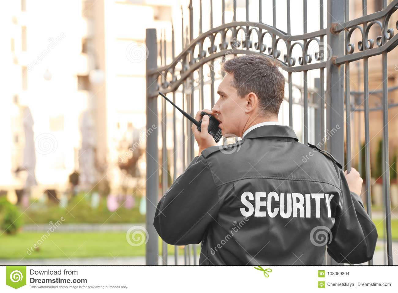Male security guard with portable radio,