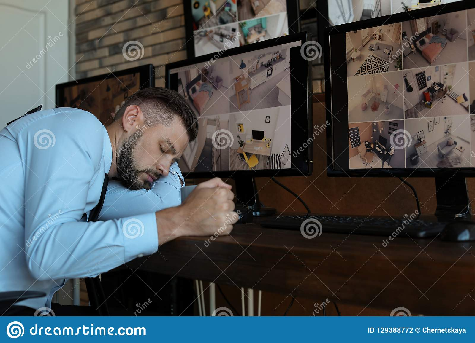 Male security guard sleeping at workplace.