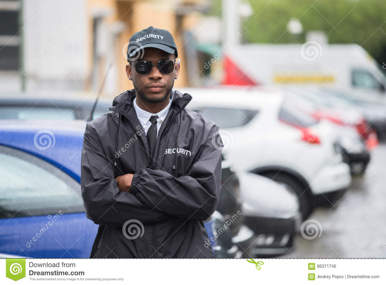 Download Male Security Guard Standing Arms Crossed On Street Stock Photo - Image of guard, police: 86371746