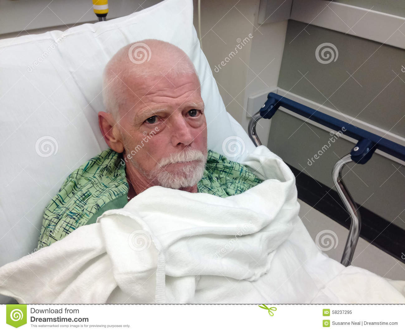 male senior hospital patient in hospital bed stock photo