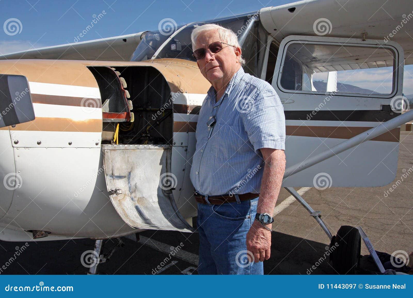 Male senior and private airplane