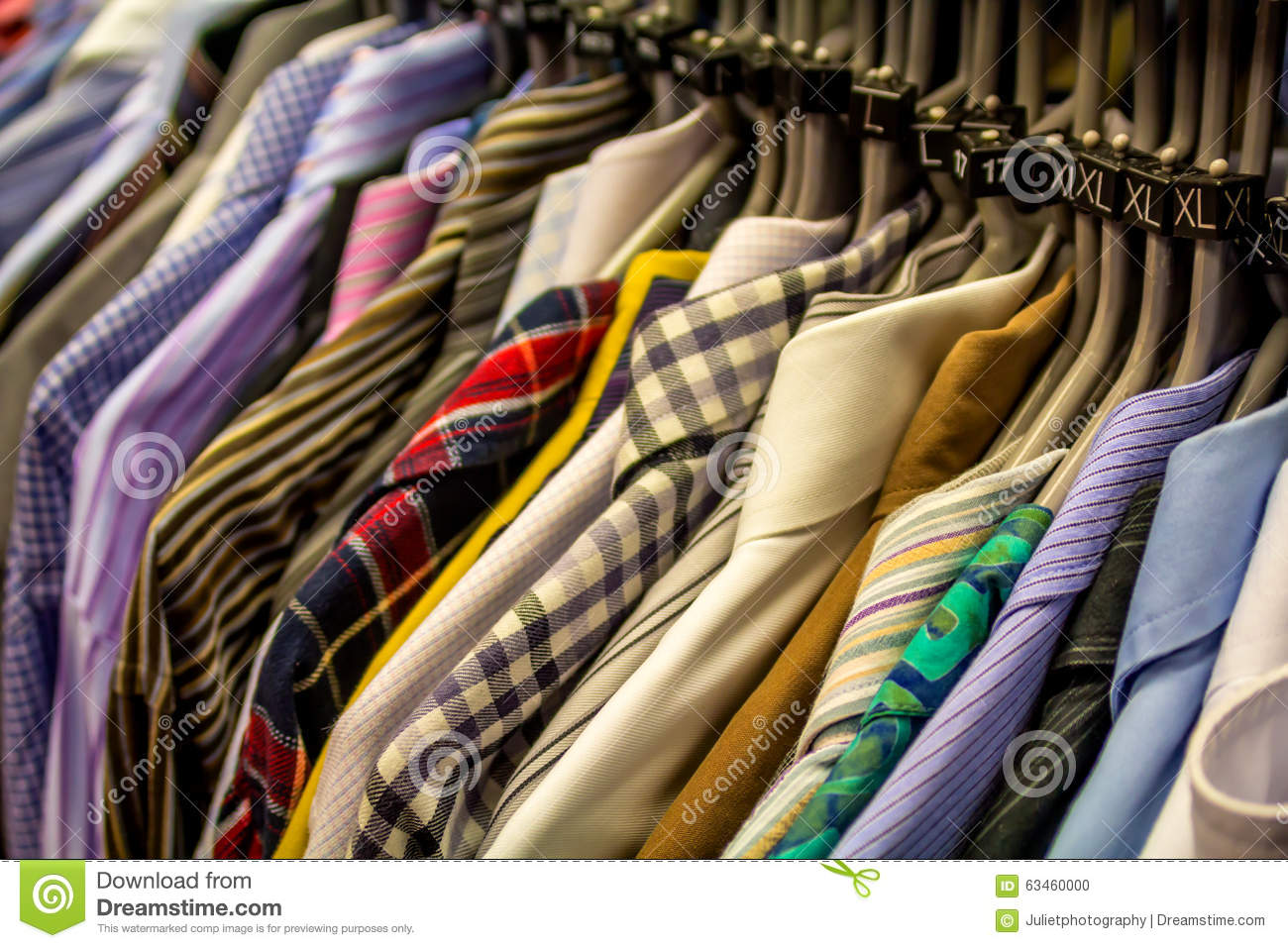 male choosing t shirts in the shop royalty free stock image 63155296. Black Bedroom Furniture Sets. Home Design Ideas