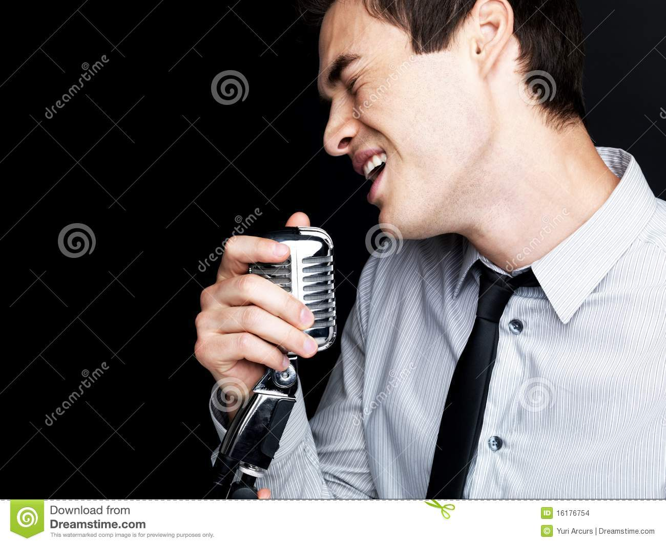 Male Singer Singing Into Old Fashioned Microphone Stock