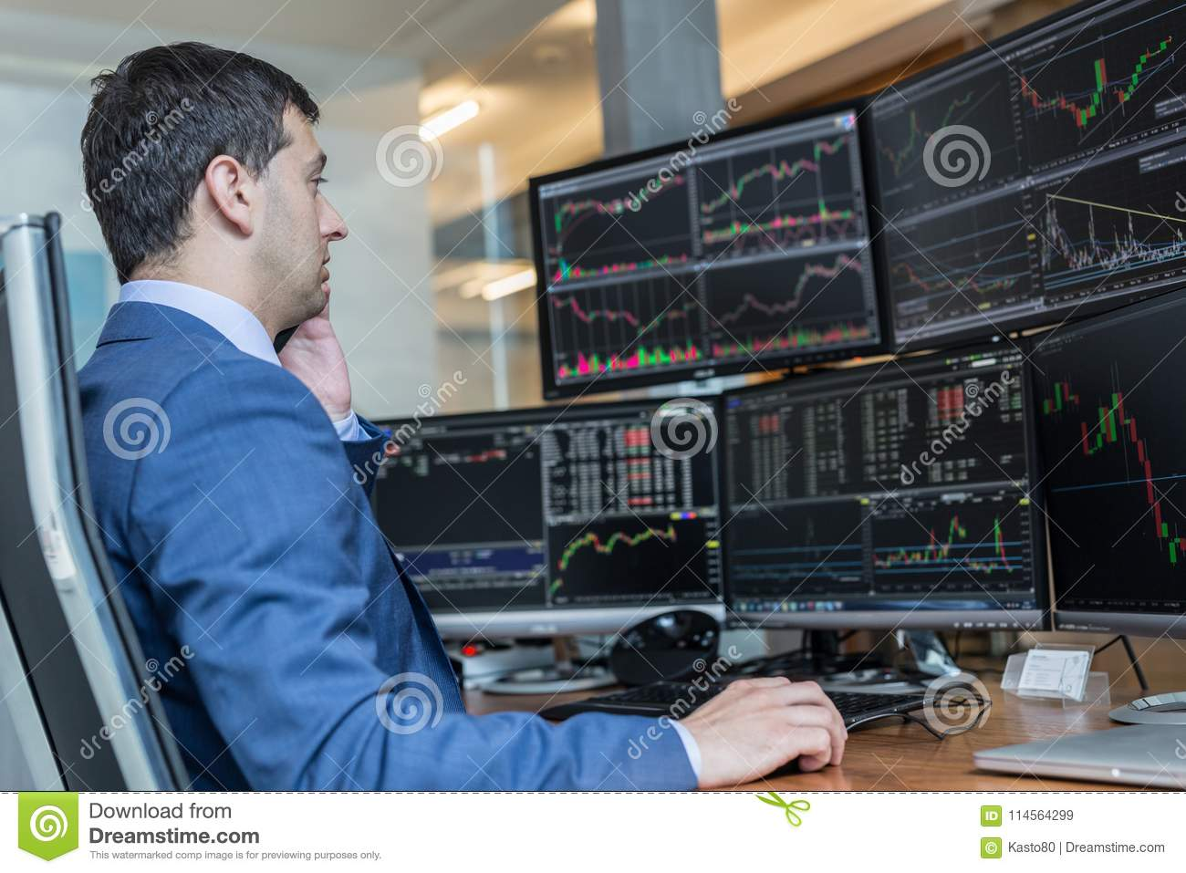 Stock broker trading online watching charts and data analyses on royalty free stock photo geenschuldenfo Image collections
