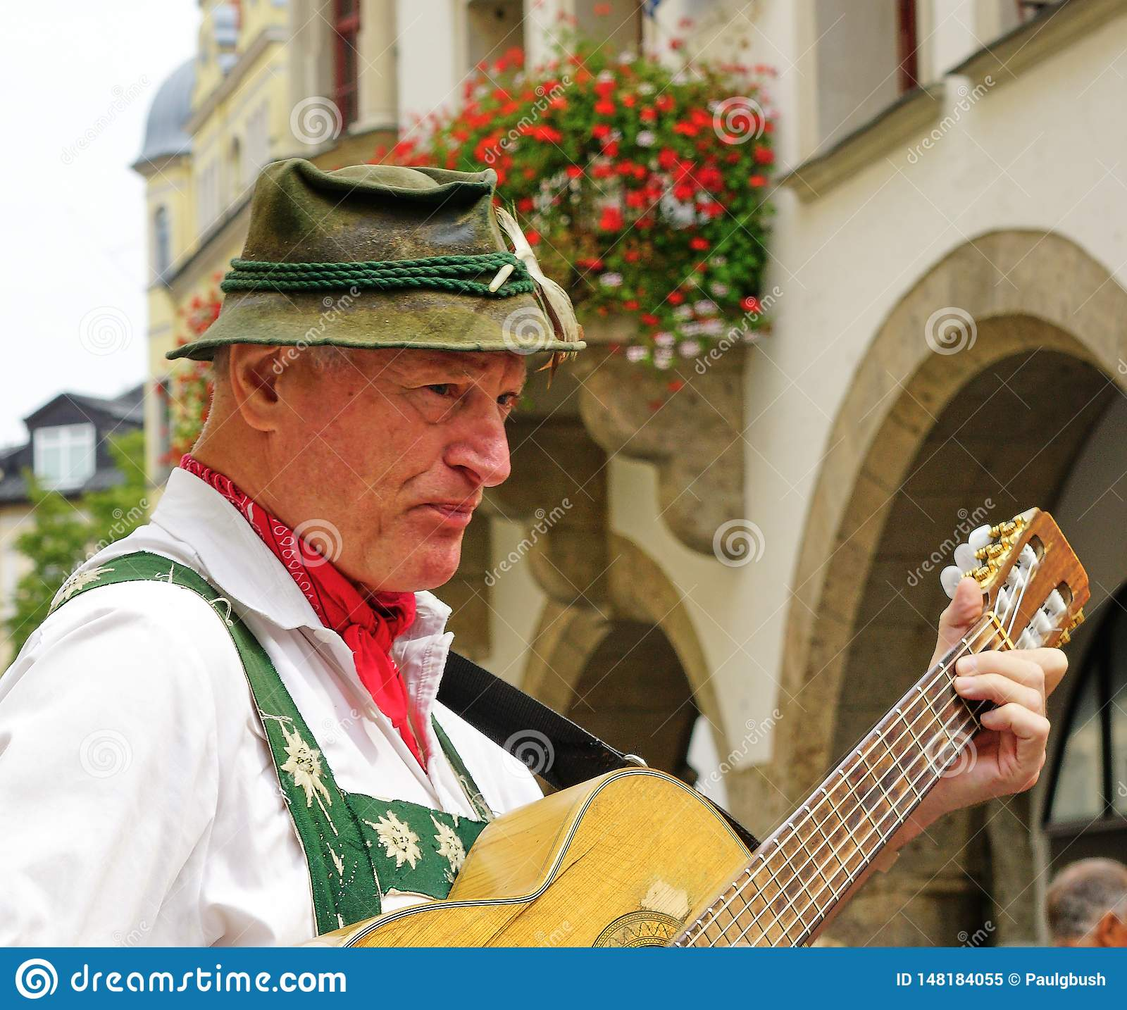 Male Street Performer in Traditional Bavarian Clothing