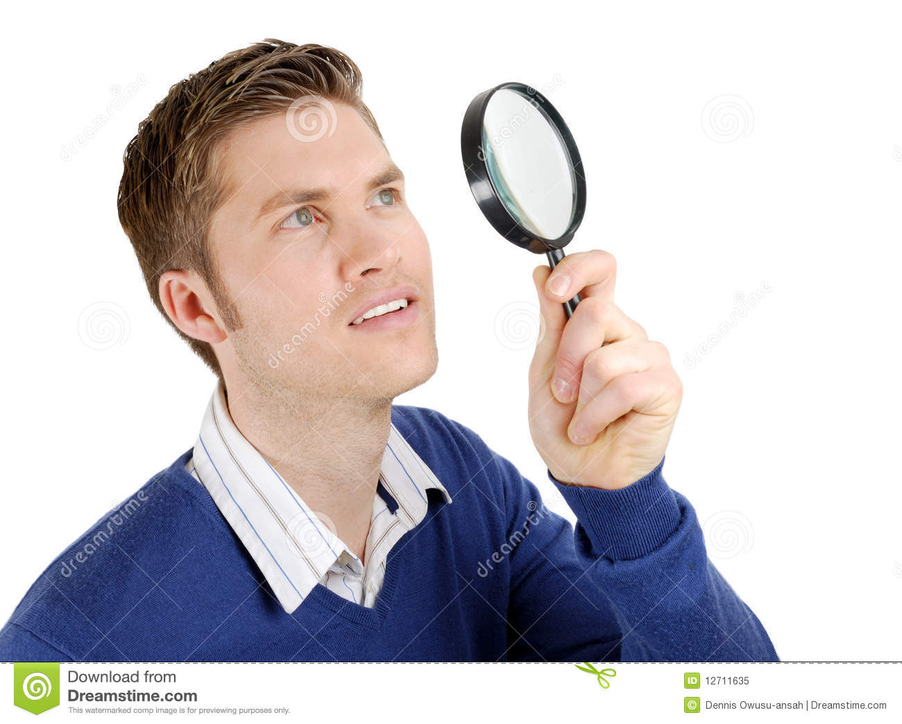 Male Student Looking Through A Magnifying Glass Stock