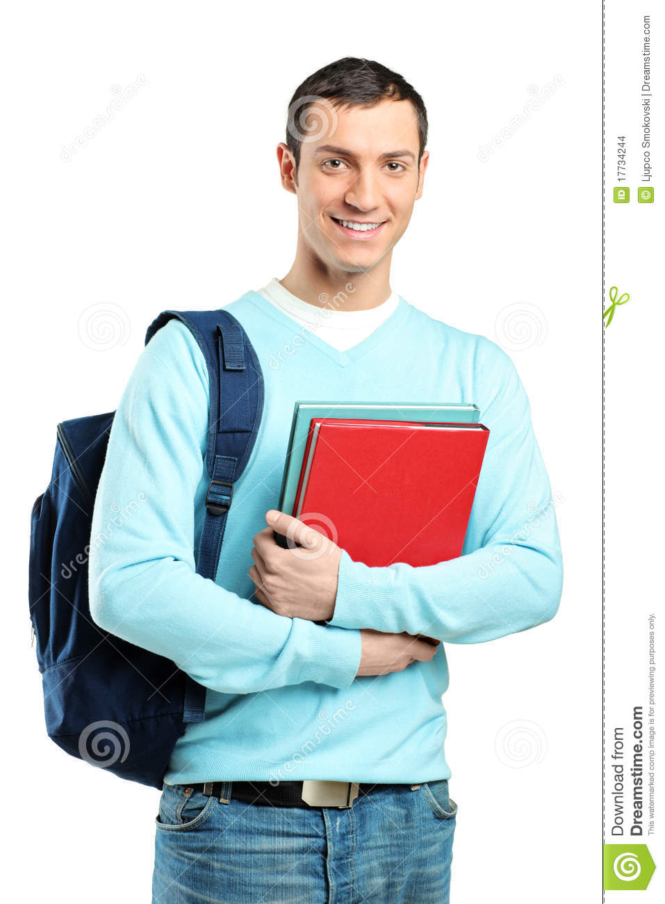 Male student with a school bag holding books stock images image