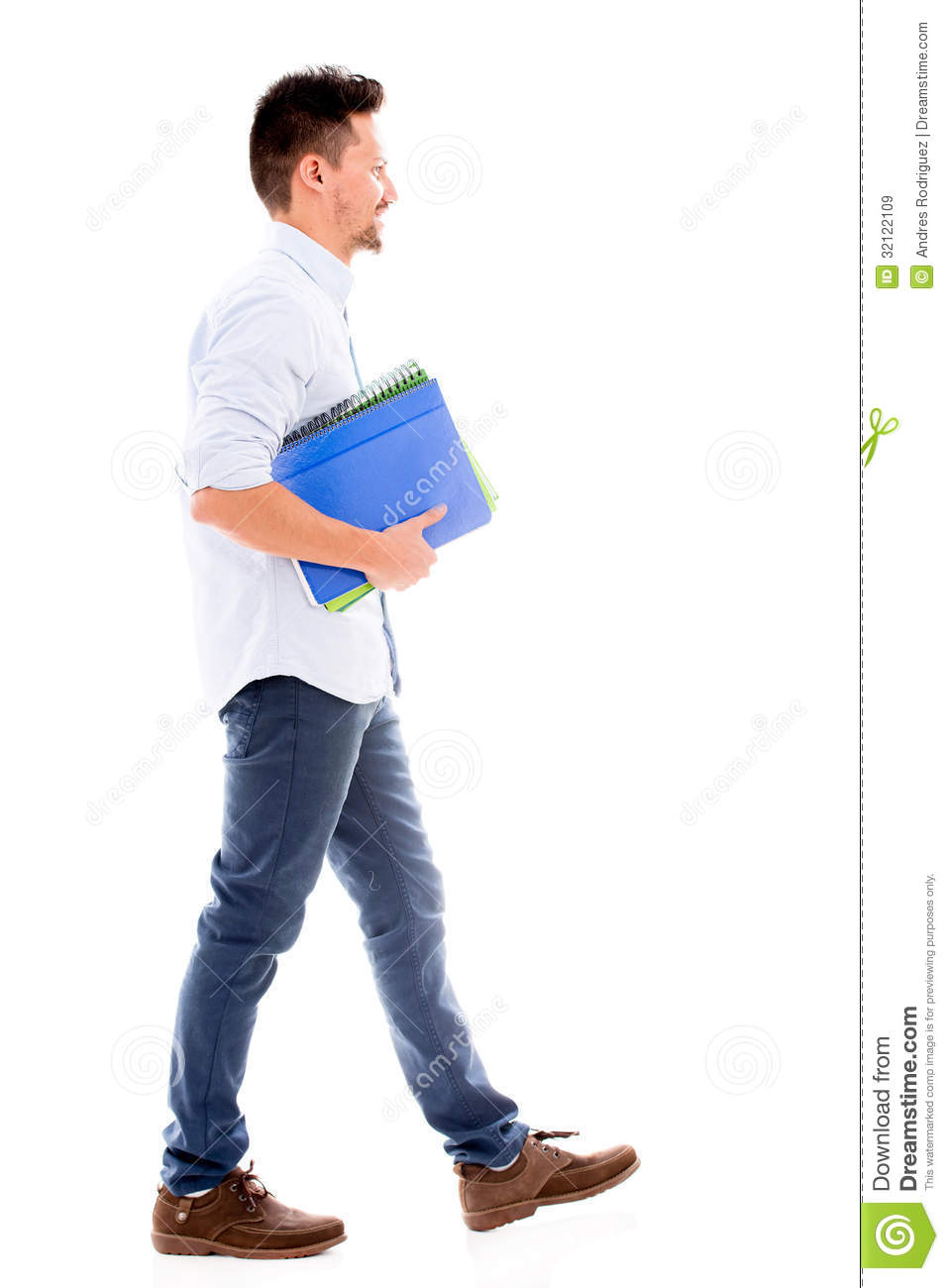 Male student walking and holding notebooks - isolated over white ...