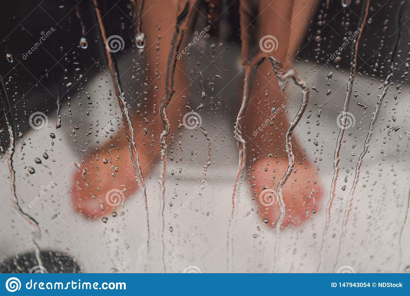 Male feet in the shower