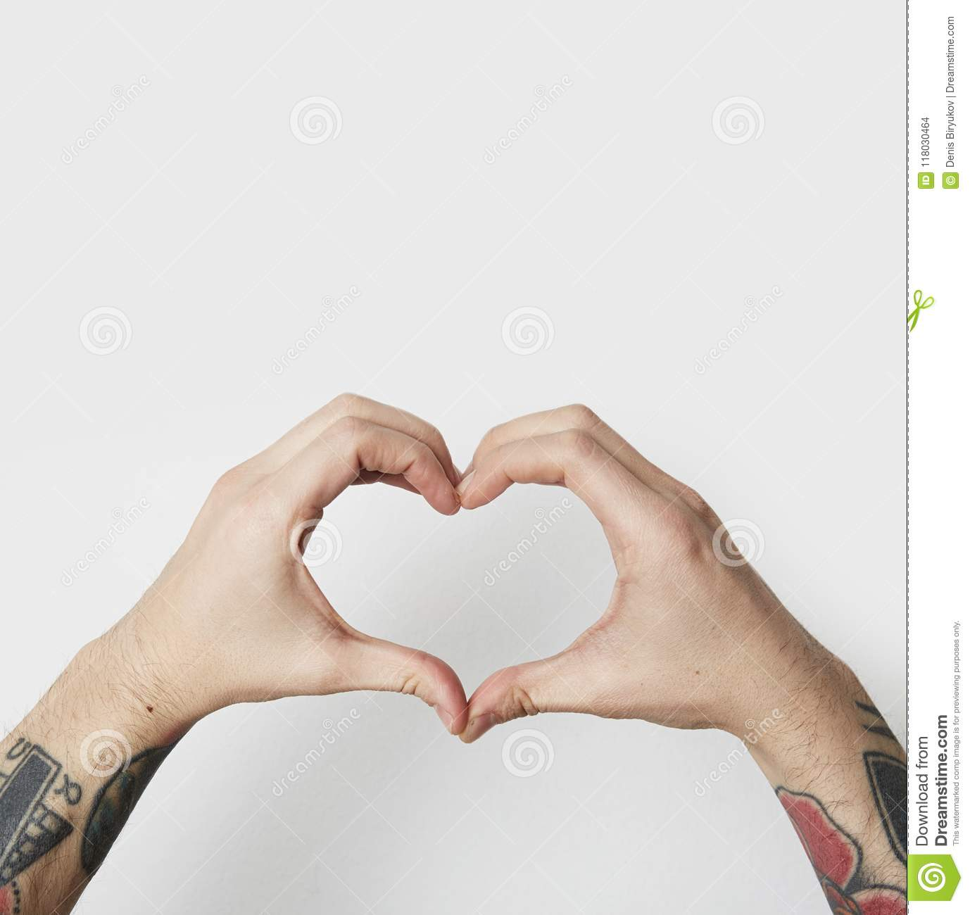 Male Tattoo Hands Shaping A Heart Symbol On White Background Stock