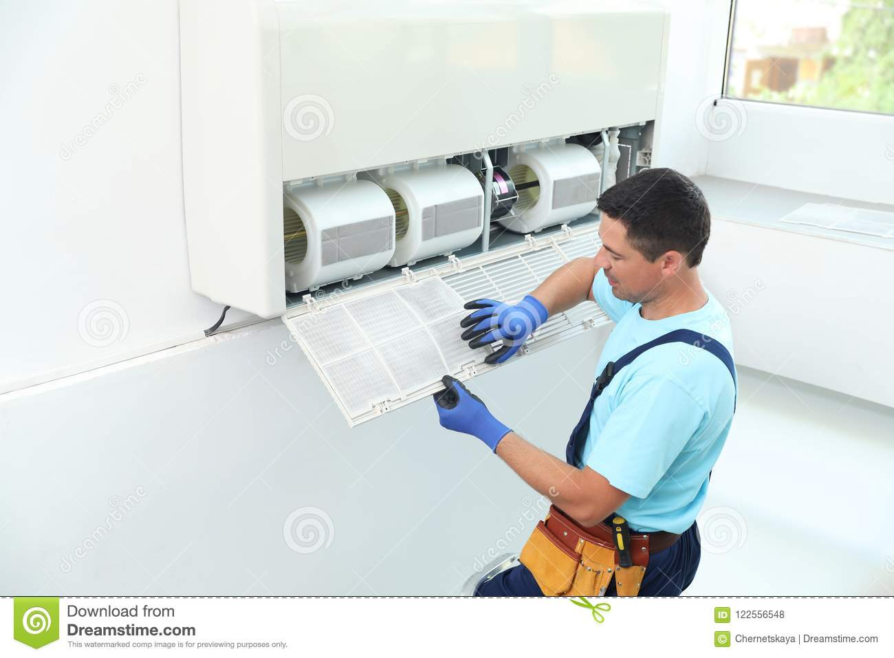 Male Technician Cleaning Air Conditioner Stock Photo - Image