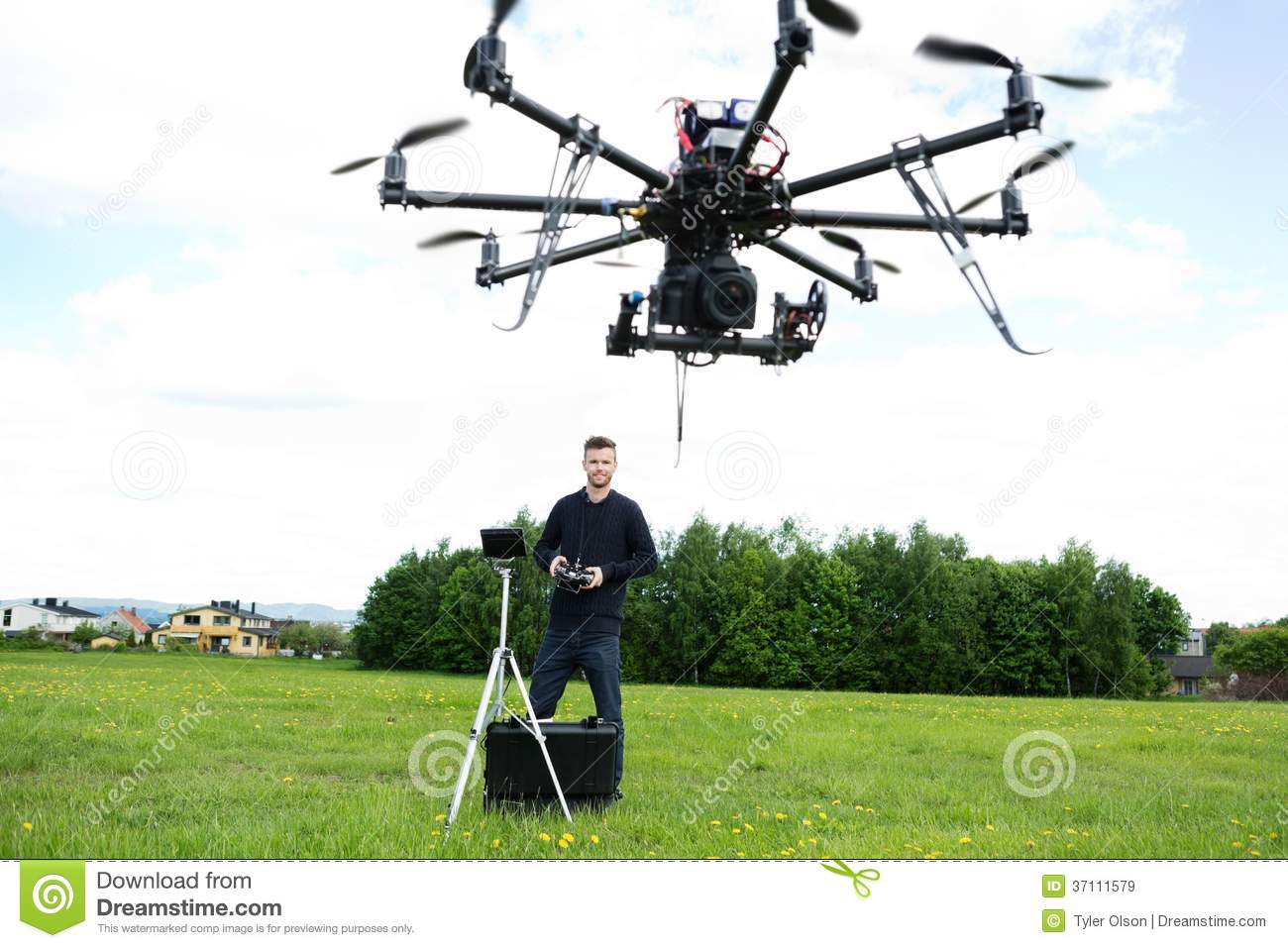Male Technician Flying UAV Octocopter