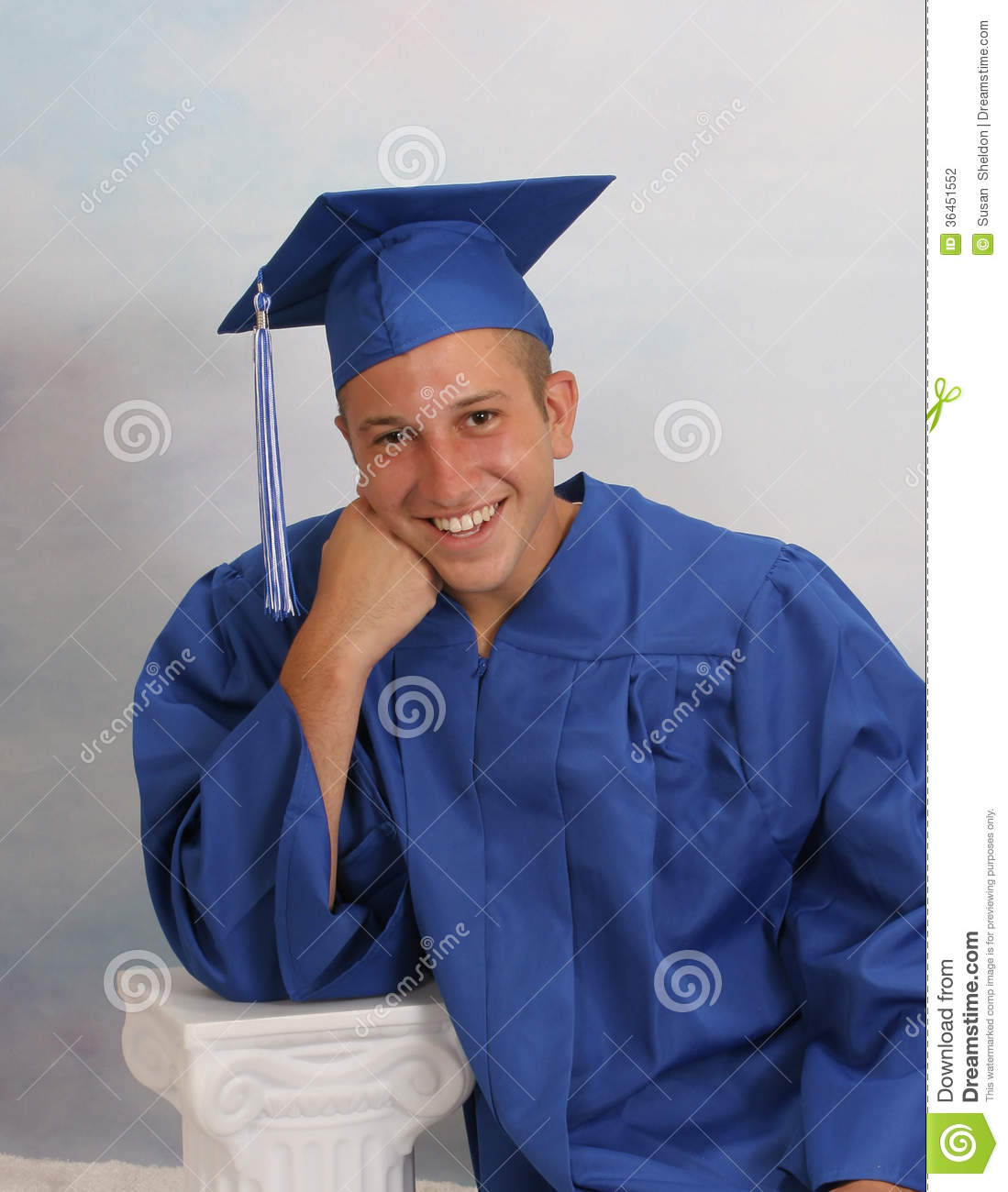 Male Teen in cap and gown stock photo. Image of education - 36451552