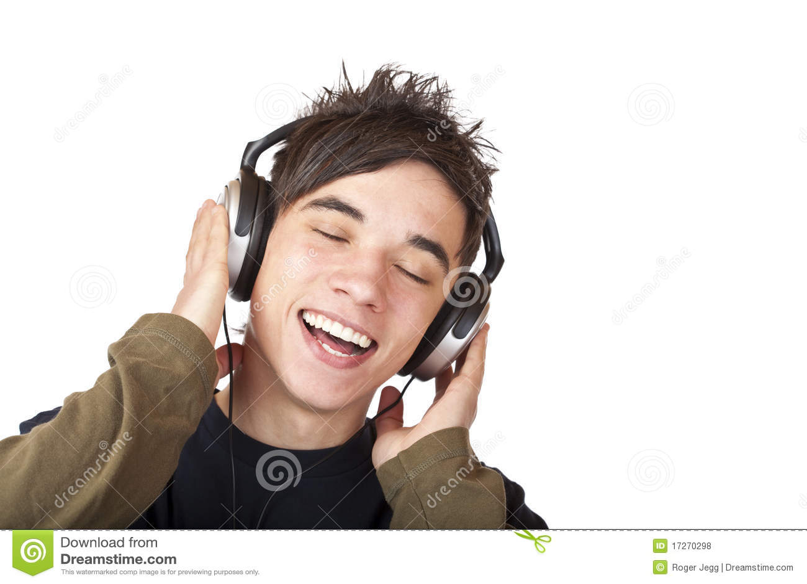 Male Teenager Listening To Music Via Headphones Stock ...