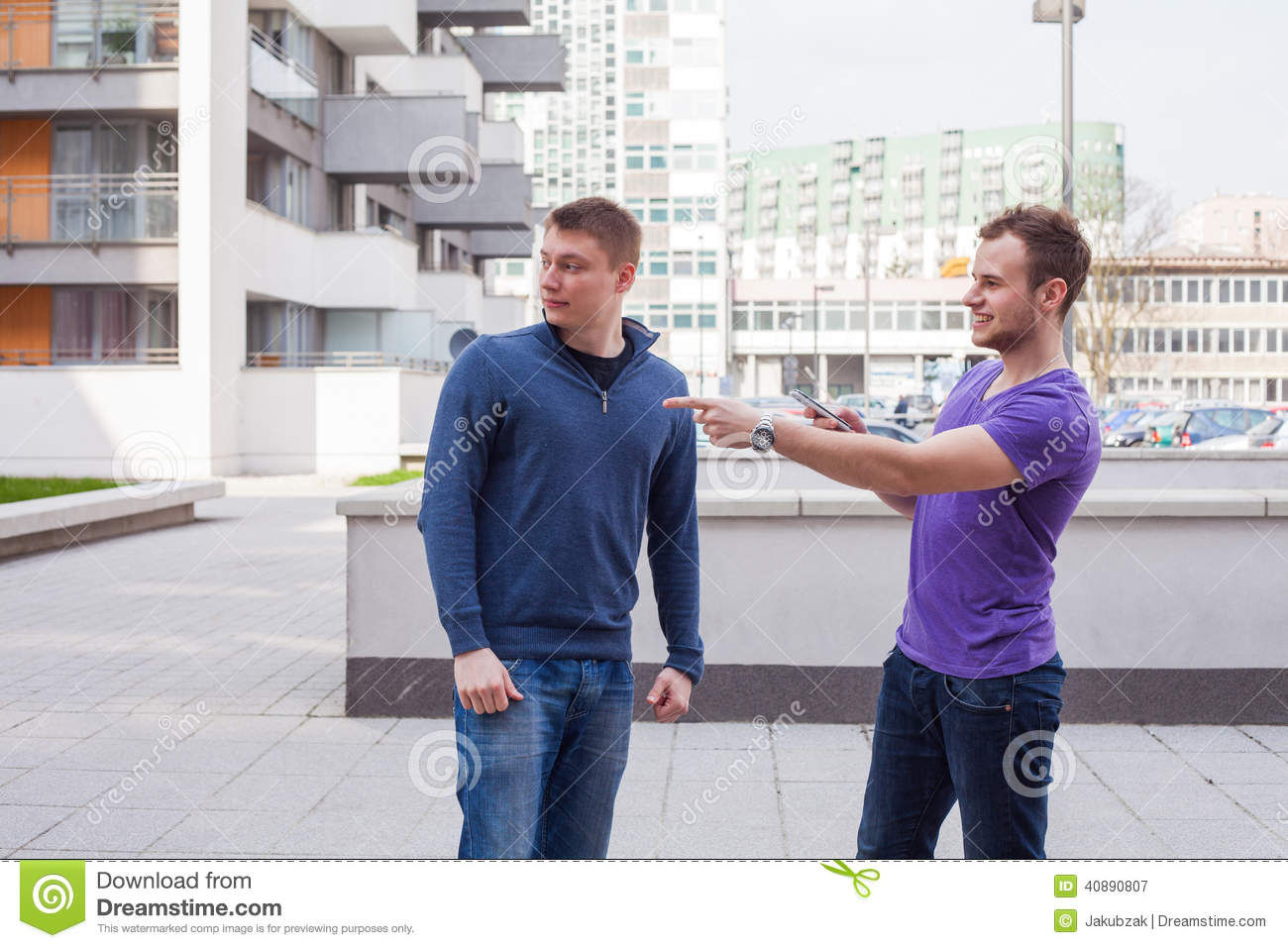 Male Tourist Asks For Directions From Man With Mobile