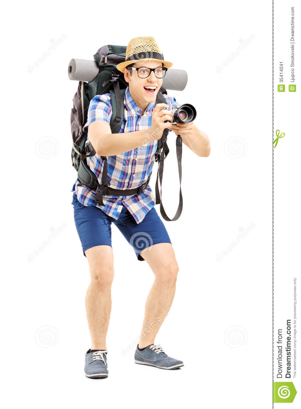 Full length portrait of a male tourist with backpack taking a picture ...