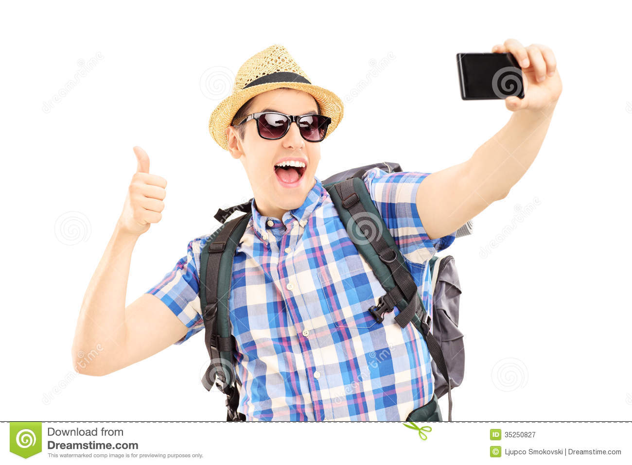 Male Tourist Taking Pictures Of Himselves With Phone And
