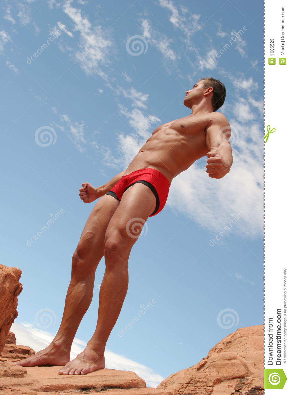 Athletic, muscular man in red briefs.