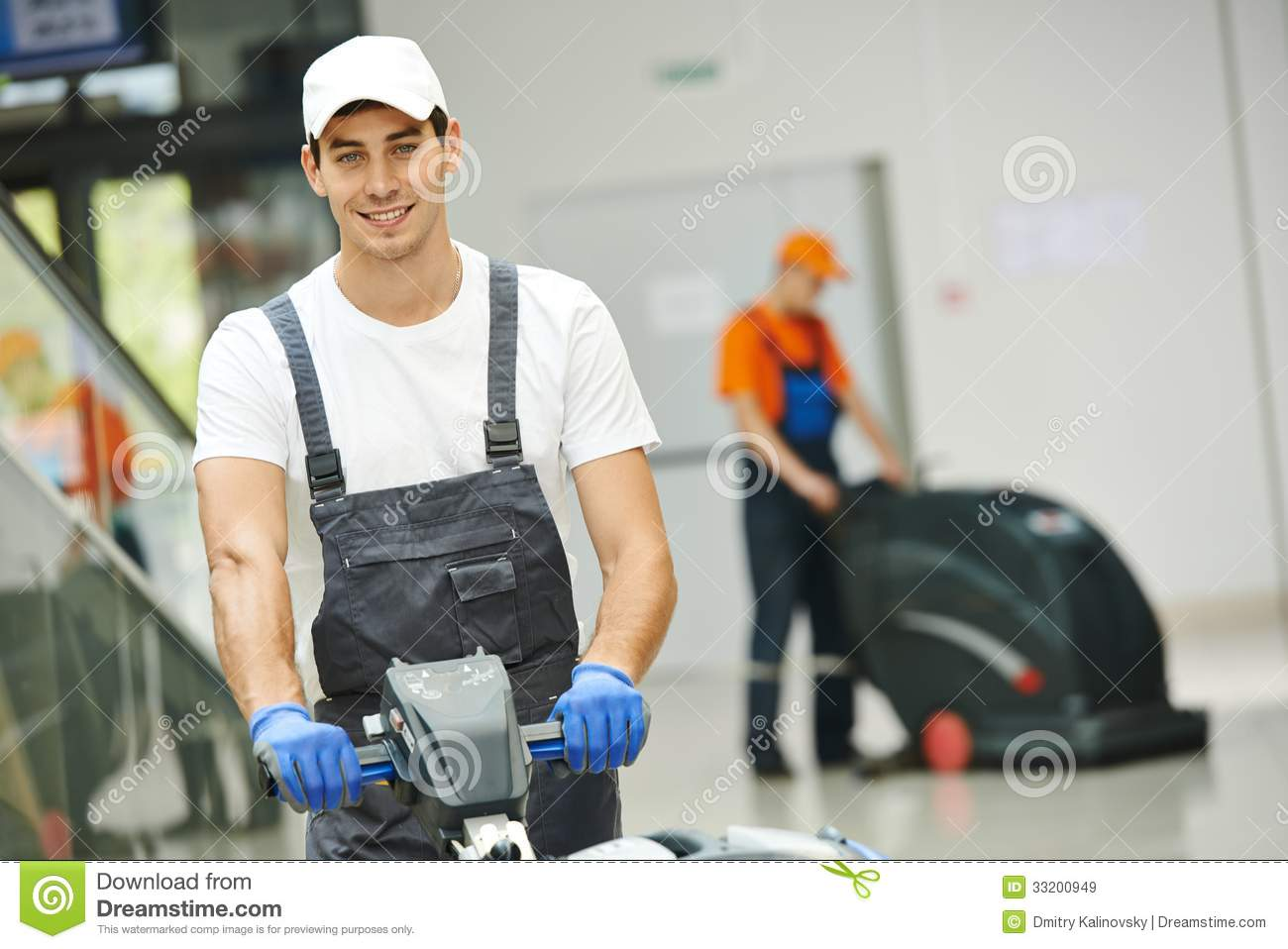 male worker cleaning business hall royalty free stock