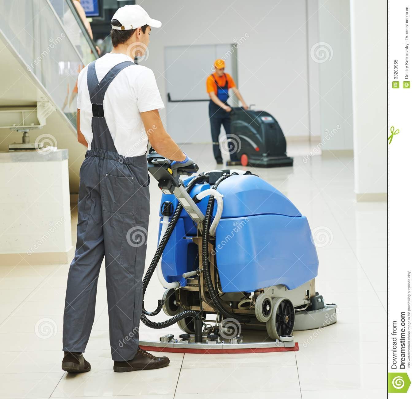 Male worker cleaning business hall stock image image of for Builder floor