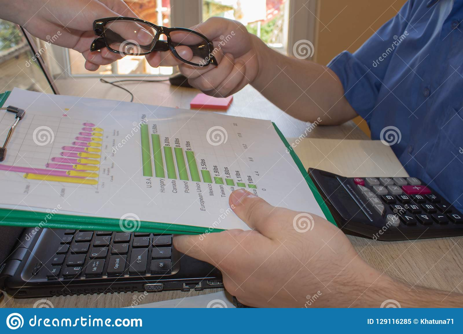 Male Working With Calculator And Business Document