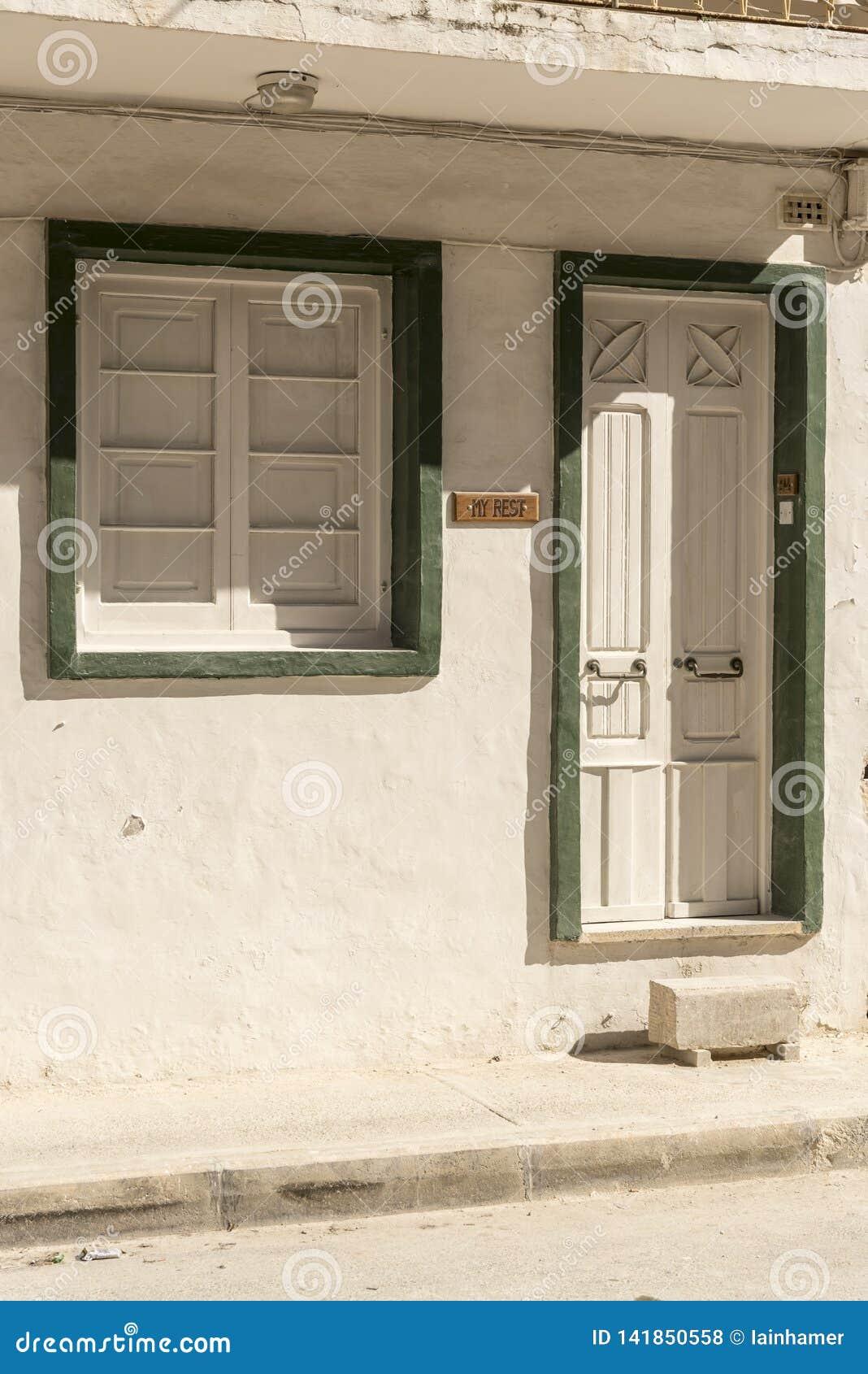 Doorway and window on a street near Gillieru Harbour Malta