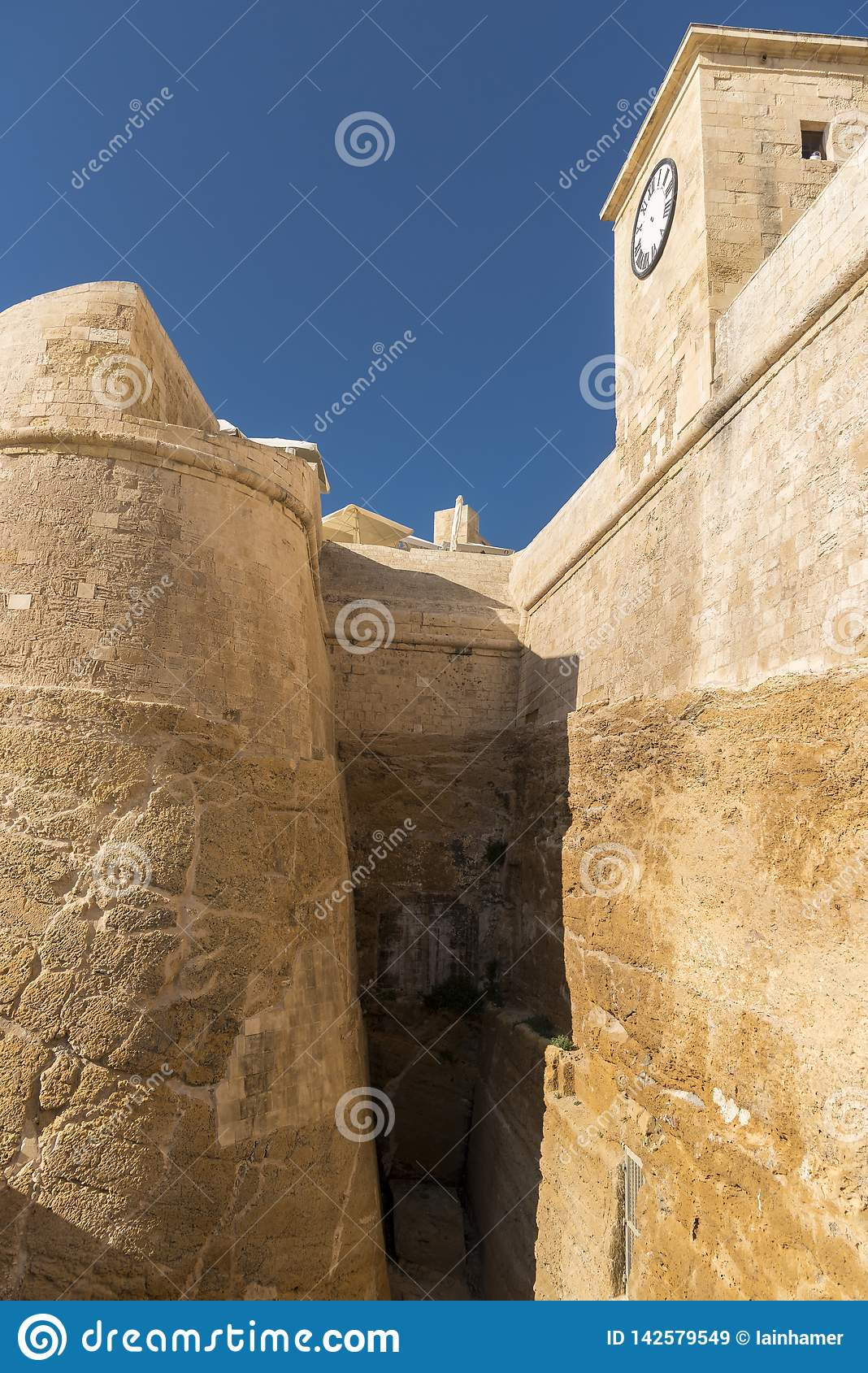 The walls and clock of the Citadel Victoria Gozo