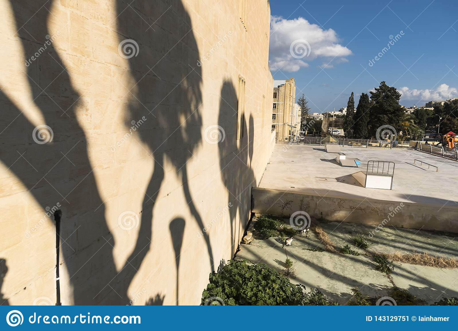Shadowed wall and playground Victoria Gozo
