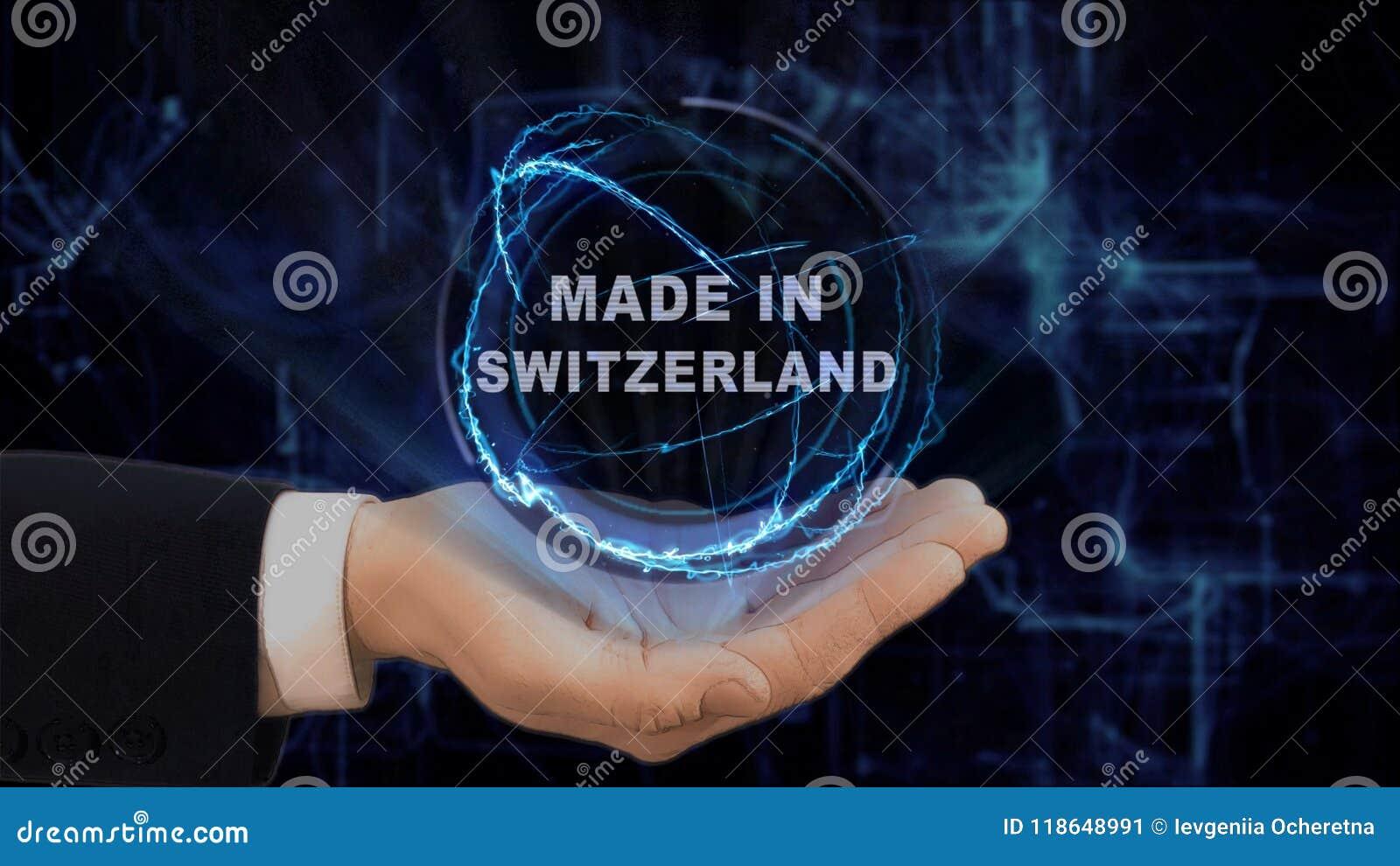 Malująca ręka pokazuje pojęcie hologram Robić w Szwajcaria jego ręka