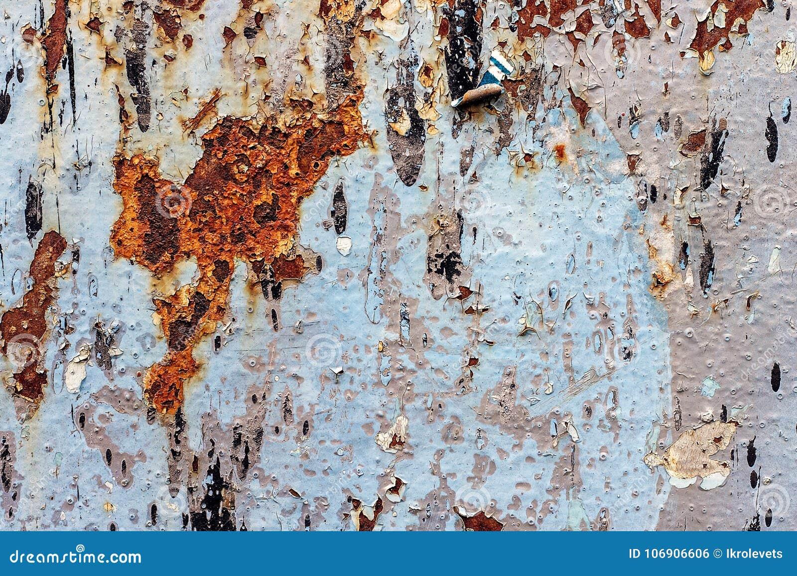 Malujący żelazny tło z wielkim ośniedziałym punktem i metali corros