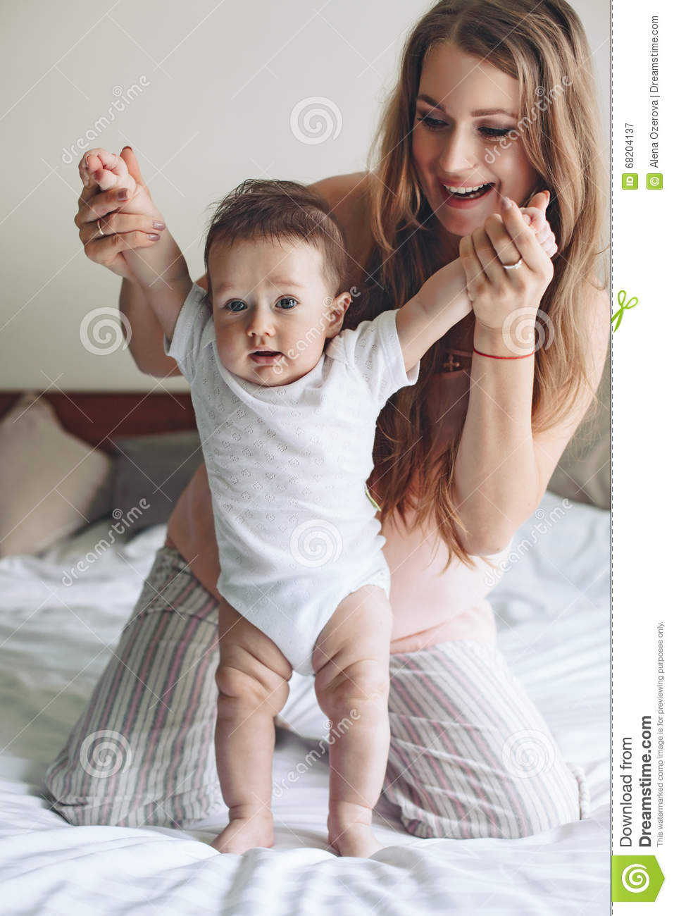Mama with baby stock image. Image of baby, people, adult - 68204137