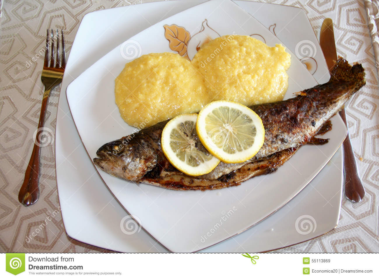 Mamaliga And Whole Grilled Fish Whith Lemon Slices Stock Photo - Image ...