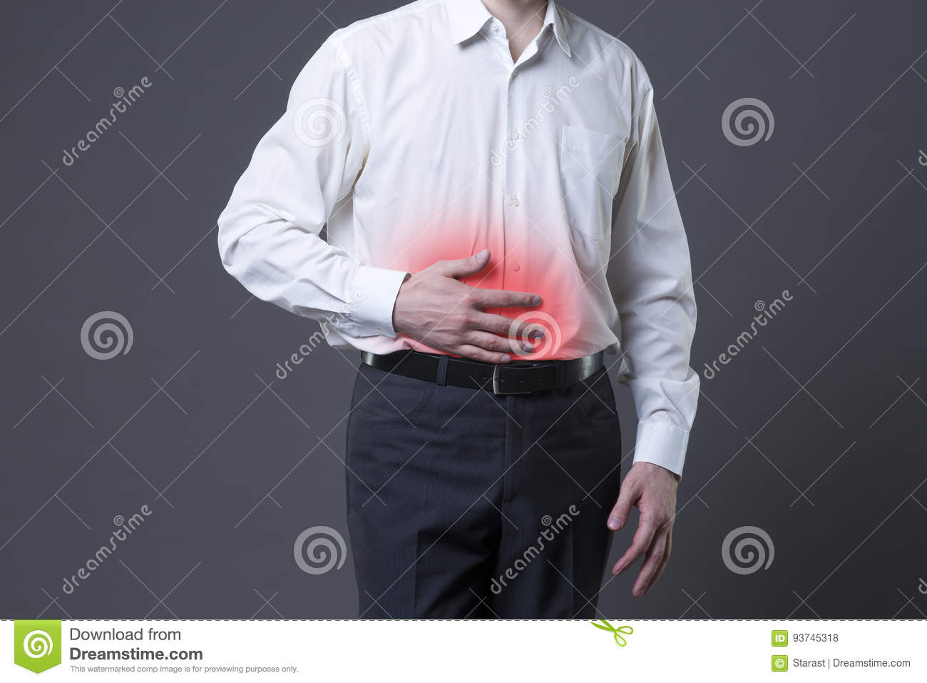 Man with abdominal pain, stomach ache on gray background