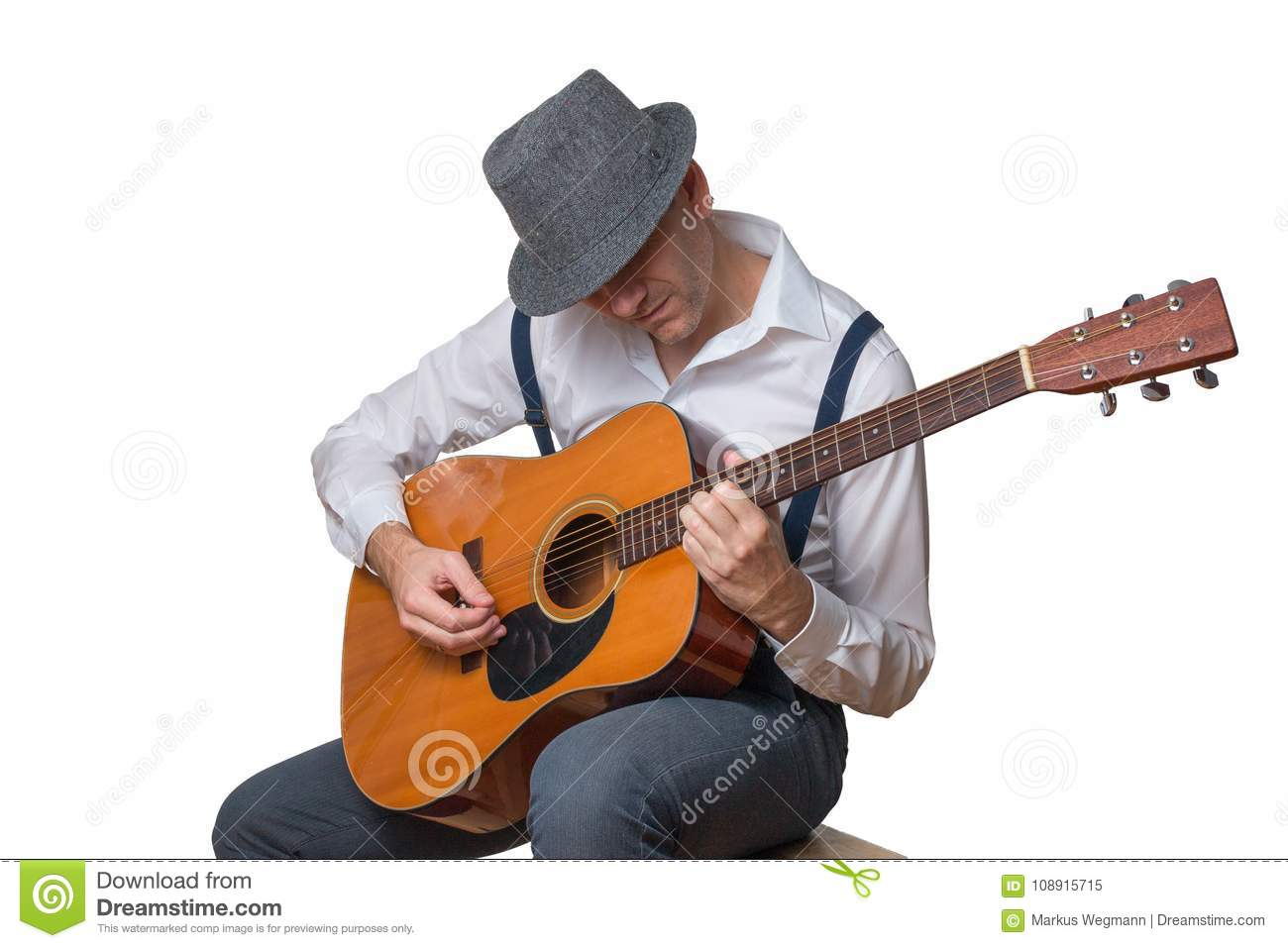 Man with acoustic guitar wearing hat isolated on white