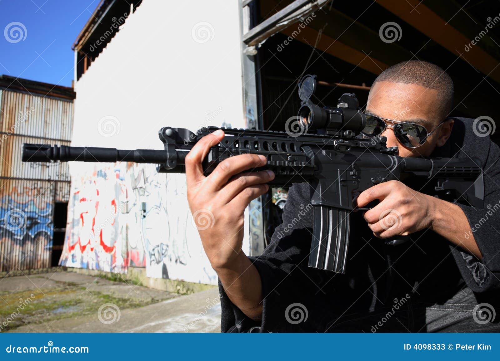 Man Aiming Rifle Stock Photos - Image: 4098333