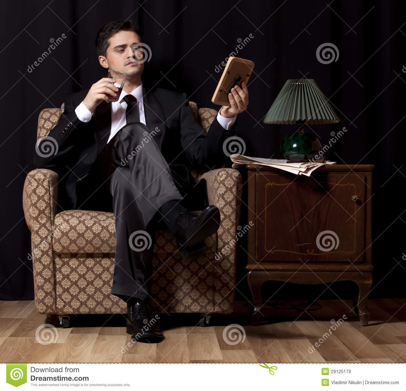 Man with alcohol sitting in vintage armchair royalty free for Sitting in armchair